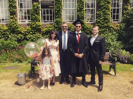 Michael Boulos with his family at his graduation