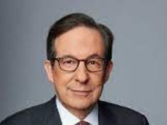 Chris Wallace wearing a suit