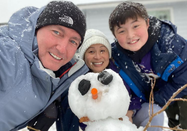 Jenni Lee with her husband and son