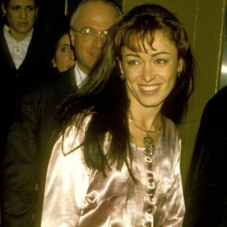 Ana Leza posing for a photo at a party