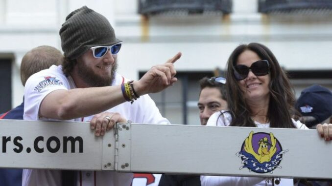 Ashley Saltalamacchia with her husband waving to the crowd