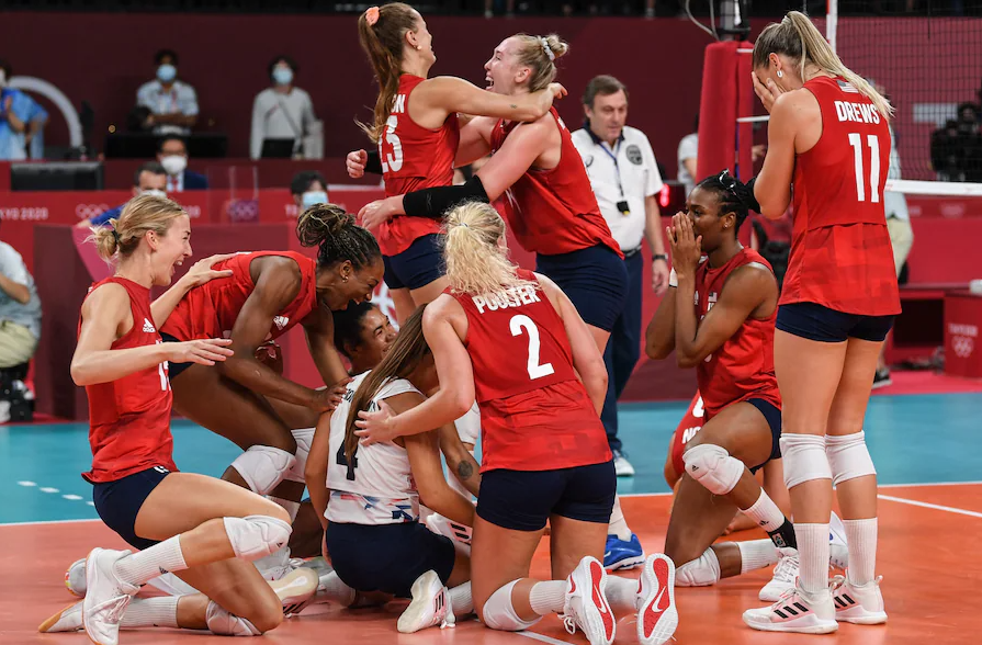 U.S. volleyball team celebrating their gold medal victory