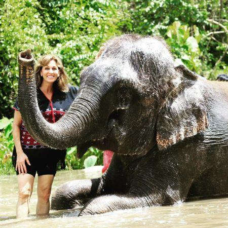Janet Shamlian bathing an elephant and enjoying her vacation in Thailand.