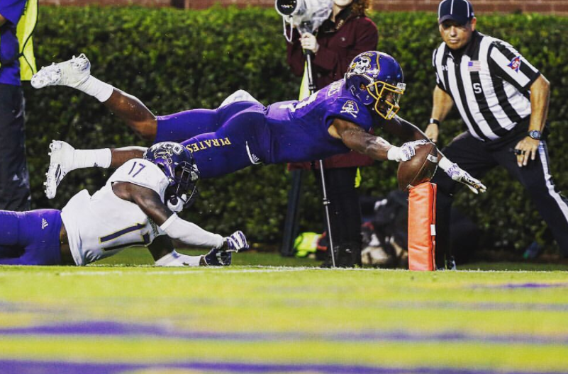 Zay Jones with the ball against the opponent