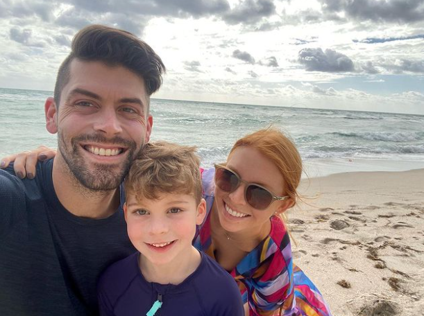 Justin Tucker with his wife and their son
