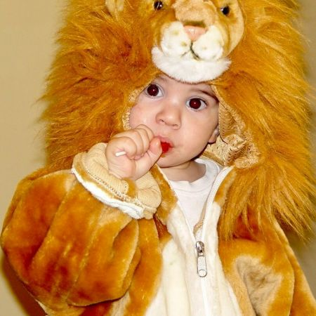 Christian Lalama dressed up in a lion onesie in his childhood days.